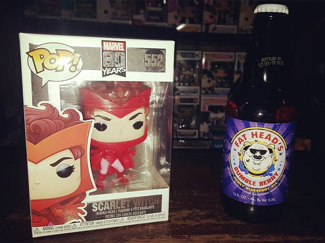 Scarlet Witch funko pop figure with Fat Heads Bumble Berry beer.