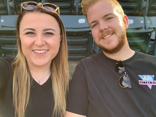 Colton and girlfriend at baseball game.