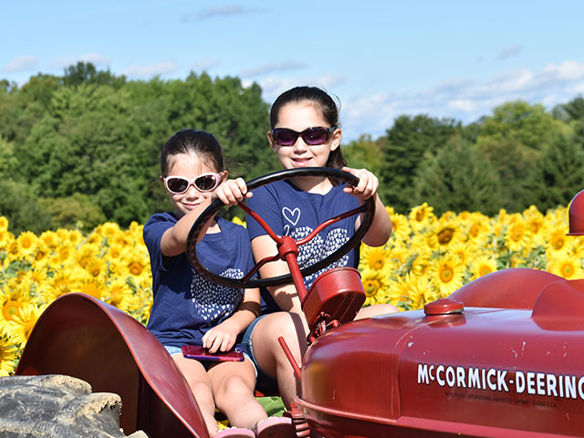 girls on a tractor